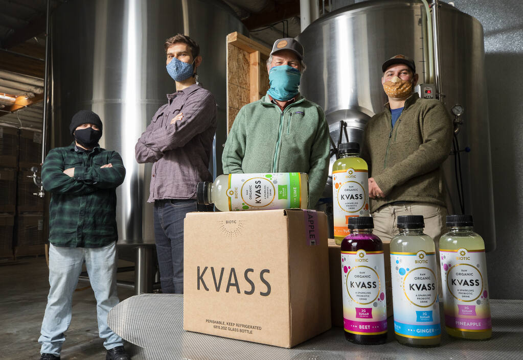 Biotic Brands co-owners, from right, Adam, Michael and Ryan Johnston with Nate de los Santos produce organic Kvass drinks without refined sugars in their Petaluma production facility. Photo taken on Friday, December 11, 2020.  (Photo by John Burgess/The Press Democrat)