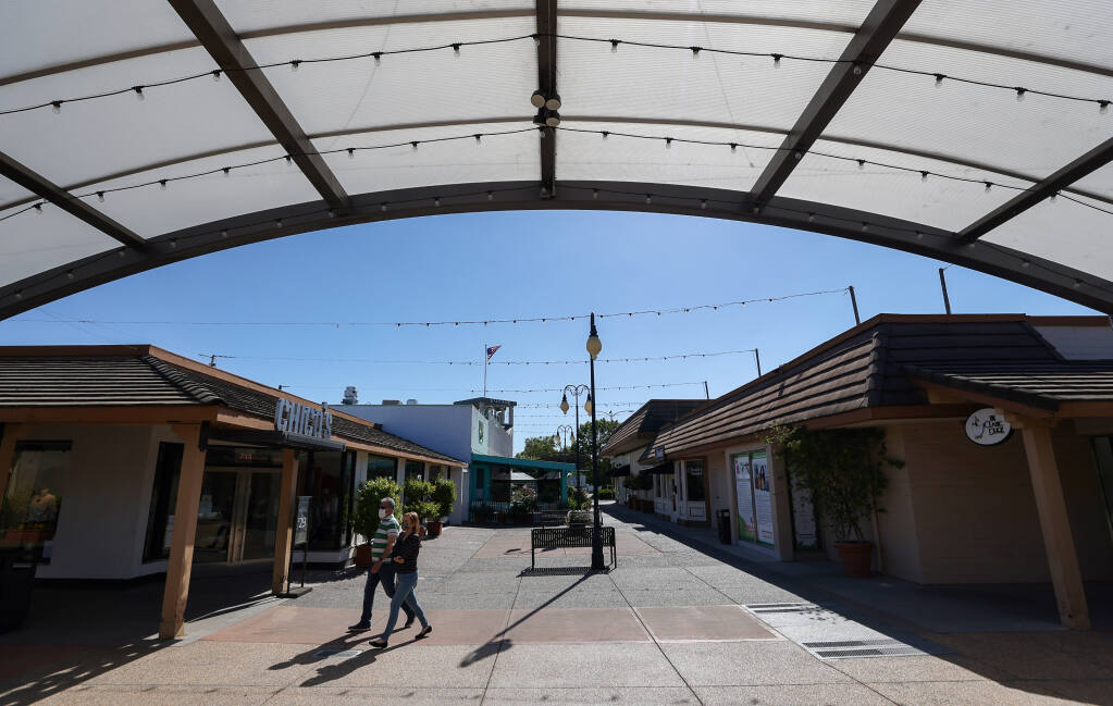 Shoppers walk through a courtyard at Montgomery Village in Santa Rosa on Tuesday, June 8, 2021.  (Christopher Chung/ The Press Democrat)