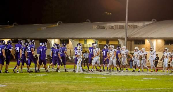 Petaluma's and Vintage's players shake hands after their football game at Petaluma High School on Friday, September 4, 2015. (JOHN O'HARA /FOR THE ARGUS-COURIER)