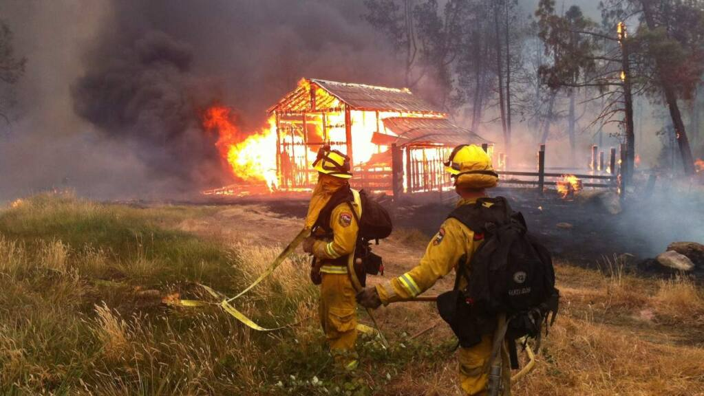 Started on Sept. 12, 2015 the cause of the Valley Fire was electrical. The blaze burnt 76,067 acres in Lake County and destroyed 1,955 structures including; 1,281 homes, 27 multi-family structures, 66 commercial properties, and 581 other minor structures largely around the town of Middletown. Four firefighters were injured and four civilian fatalities were recorded. (Kent Porter / The Press Democrat)