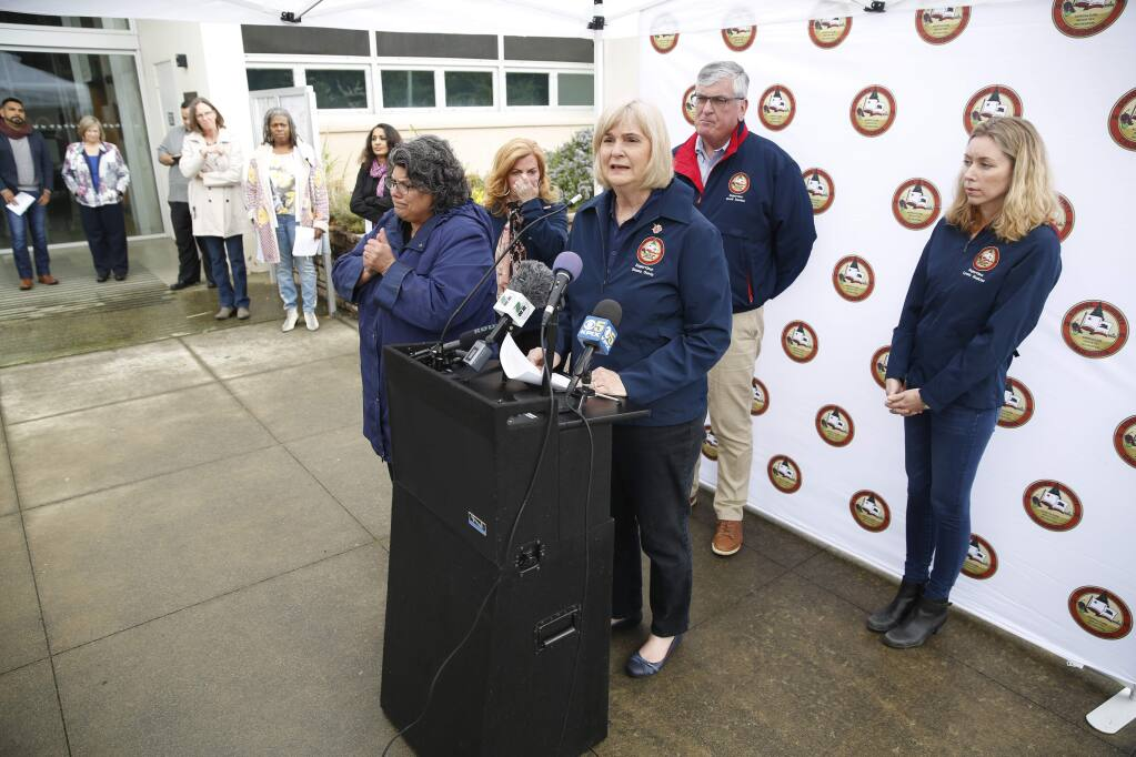 Supervisor Susan Gorin speaks during a press conference about the first community spread case of the coronavirus and the local response, in mid-March, 2020. Behid her are supervisors Shirlee Zane (hands to face), David Rabbitt and Lynda Hopkins. To the left rear is Dept. of Health director Barbie Robison and health officer Sundari Mase . (BETH SCHLANKER/ The Press Democrat)