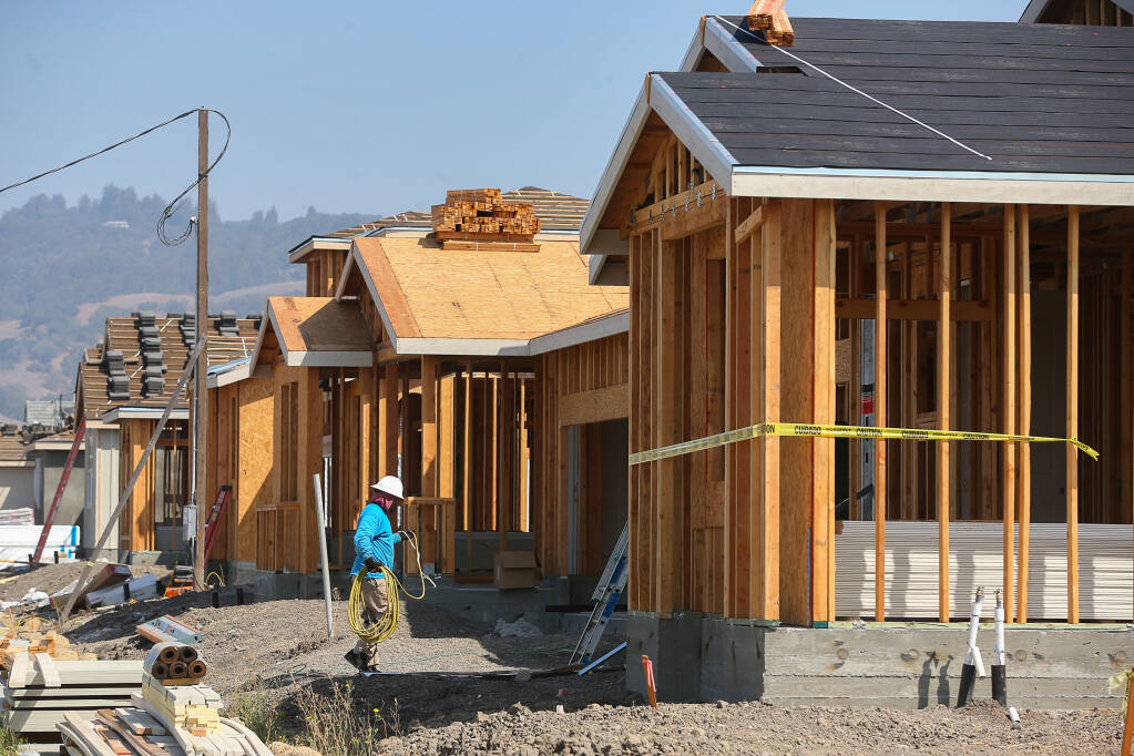 Single family homes under construction along Kristina Place, at Kingwood Road, in Rohnert Park on Thursday, Sept. 2, 2021.  (Christopher Chung/ The Press Democrat)
