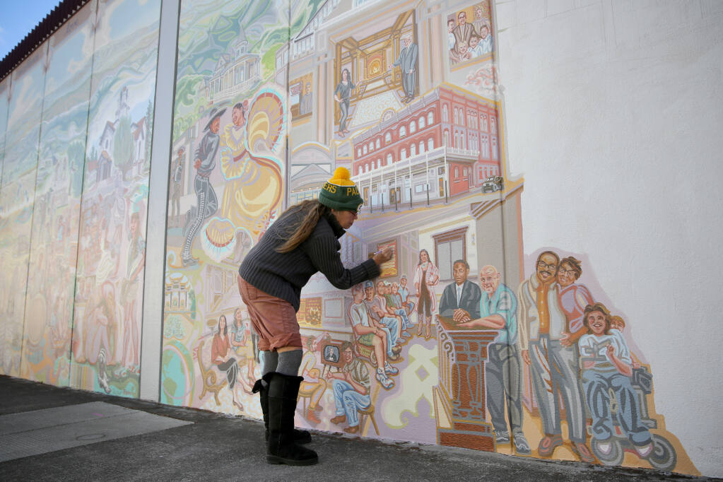 "Artist Lauren Sinnott works on the mural ""Ukiah Valley: Past, Present and Future"" on West Church Street in Ukiah on Sunday, Nov. 8, 2020. (Beth Schlanker / The Press Democrat)"