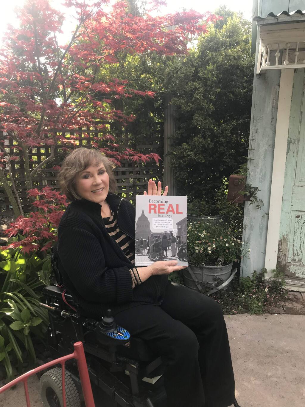 """HolLynn D'Lil of Graton with her book """"Becoming Real in 24 Days."""" (HolLynn D'Li)"""