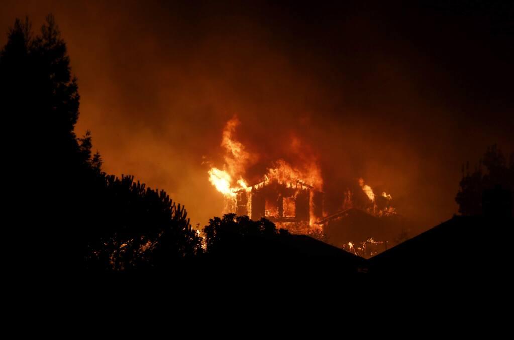 A home burns in the Fountaingrove area on Monday, October 9, 2017 in Santa Rosa, California . (BETH SCHLANKER/The Press Democrat)