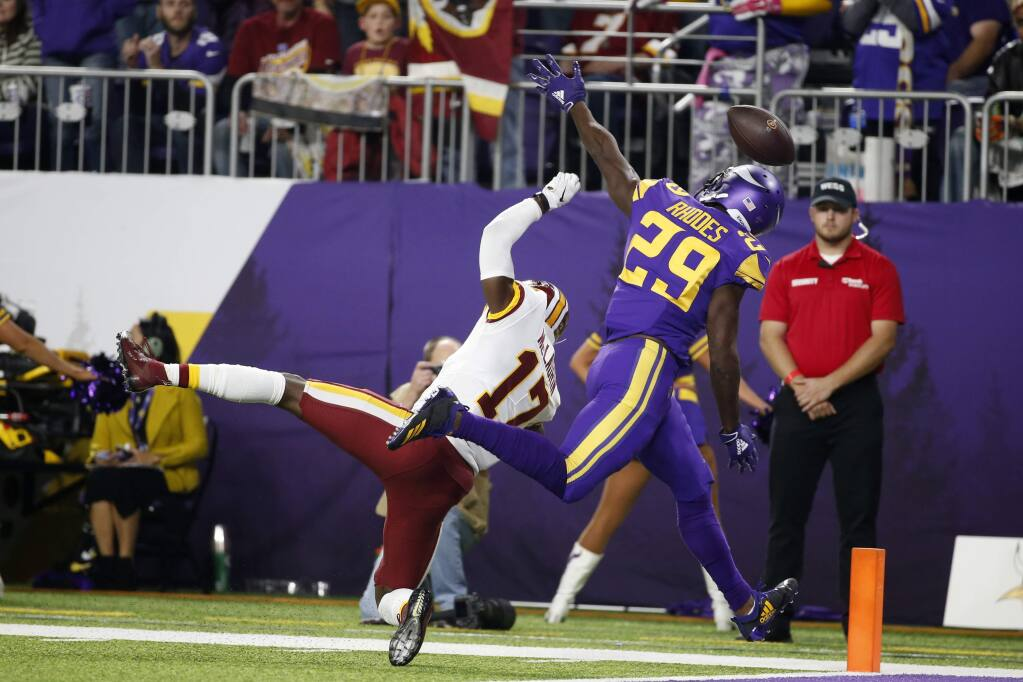 In this Oct. 24, 2019, file photo, Minnesota Vikings cornerback Xavier Rhodes (29) breaks up a pass intended for Washington Redskins wide receiver Terry McLaurin (17) during the first half in Minneapolis. (AP Photo/Bruce Kluckhohn, File)