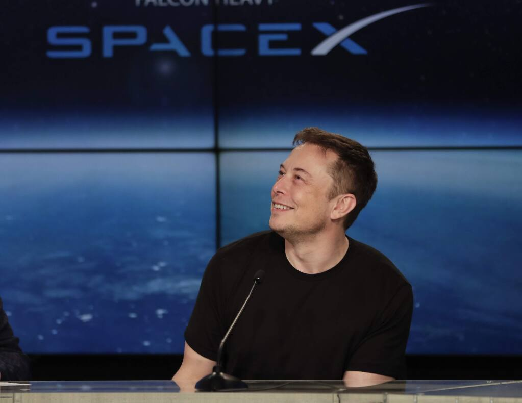 FILE- In this Feb. 6, 2018, file photo, Elon Musk, founder, CEO, and lead designer of SpaceX, speaks at a news conference after the Falcon 9 SpaceX heavy rocket launched successfully from the Kennedy Space Center in Cape Canaveral, Fla. (AP Photo/John Raoux, File)