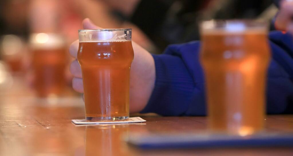 Beer lovers enjoy Pliny the Younger at Russian River Brewing Co. in 2014. (KENT PORTER/ PD FILE, 2014)