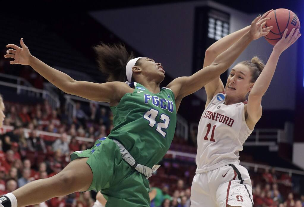 Stanford forward Alanna Smith (11) grabs a rebound against Florida Gulf Coast guard Tytionia Adderly (42) during the first half of a second-round game in the NCAA women's tournament in Stanford, Monday, March 19, 2018. (AP Photo/Jeff Chiu)