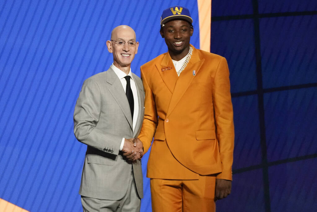 Jonathan Kuminga, right, poses for a photo with NBA Commissioner Adam Silver after being selected seventh overall by the Golden State Warriors during the NBA draft on Thursday, July 29, 2021, in New York. (Corey Sipkin / ASSOCIATED PRESS)