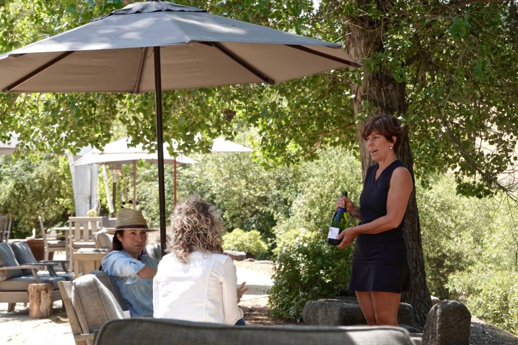 McEvoy Ranch guests enjoy the patio grounds for wine and olive oil tasting on July 3, 2021. Photo by Kathryn Reed
