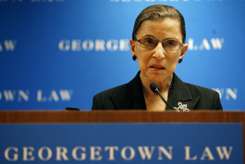 Late Supreme Court Justice Ruth Bader Ginsburg, above, speaking at Georgetown University Law Center in Washington in 2007. Ginsburg died Sept. 18. She was 87. (AP Photo/Jose Luis Magana, File)