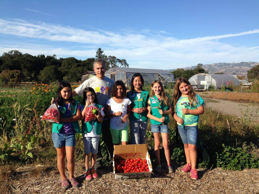 JEANINE COMELLA PHOTOMeadow School Girls Scouts make a donation to the COTS' program at Petaluma Bounty