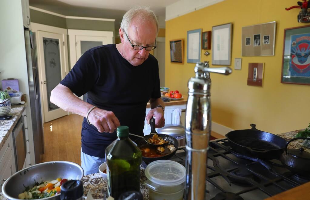 John Ash prepares Clams Escabeche in his Santa Rosa home on Thursday, September 13, 2018. (Christopher Chung/ The Press Democrat)