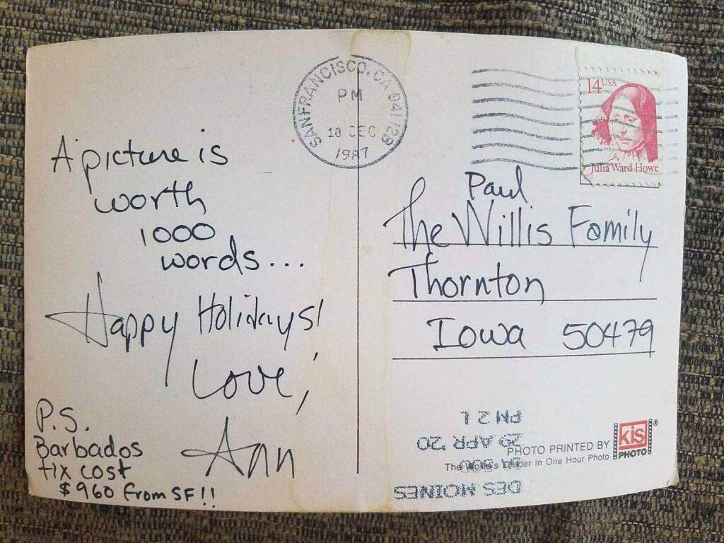 Annie Lovell's holiday postcared to her brother bears postmarks from both 1987 and this past April 29. Lovell mentioned possible travel to Barbados because her brother had worked there for a time, teaching sustainable hog-farmer practices. (Annie Lovell)