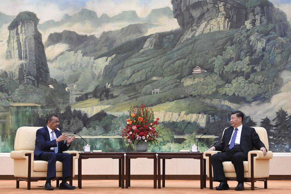 "FILE - In this Jan. 28, 2020, file photo, Tedros Adhanom Ghebreyesus, director general of the World Health Organization, left, meets with Chinese President Xi Jinping at the Great Hall of the People in Beijing. Throughout January, the World Health Organization publicly praised China for what it called a speedy response to the new coronavirus. It repeatedly thanked the Chinese government for sharing the genetic map of the virus ""immediately"" and said its work and commitment to transparency were ""very impressive, and beyond words."" But behind the scenes, there were significant delays by China and considerable frustration among WHO officials over the lack of outbreak data, The Associated Press has found. (Naohiko Hatta/Pool Photo via AP, File)"