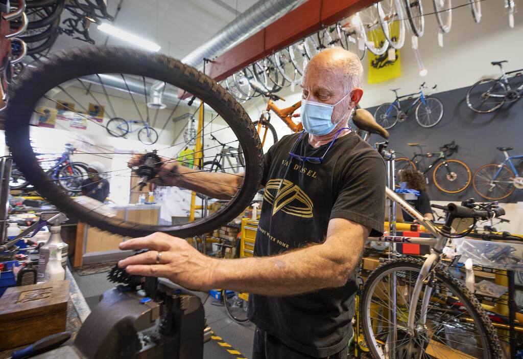 Denver Booker, owner of the Sebastopol Bike Center, replaces a cassette gear for a customer on Monday, July 20, 2020. Booker has seen demand increase, but his suppliers are struggling during the pandemic. (John Burgess/The Press Democrat)