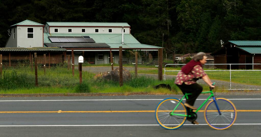 A cyclist pedals along Armstrong Woods Road in Guerneville, California, on Friday, March 17, 2017. (ALVIN JORNADA/ PD)