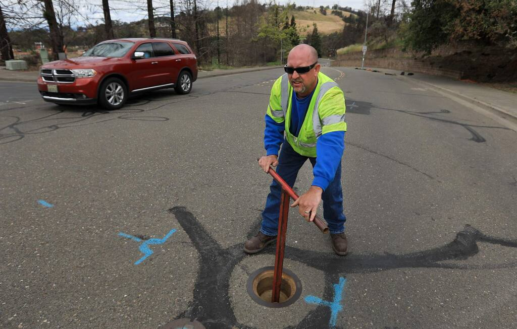 Anthony Drolet, a utility systems operators with the City of Santa Rosa, turns a valve to let water flow to a fire hydrant used to flush a water line in the Foutaingrove area of Santa Rosa, Wednesday, May 16, 2018, (Kent Porter / The Press Democrat) 2018