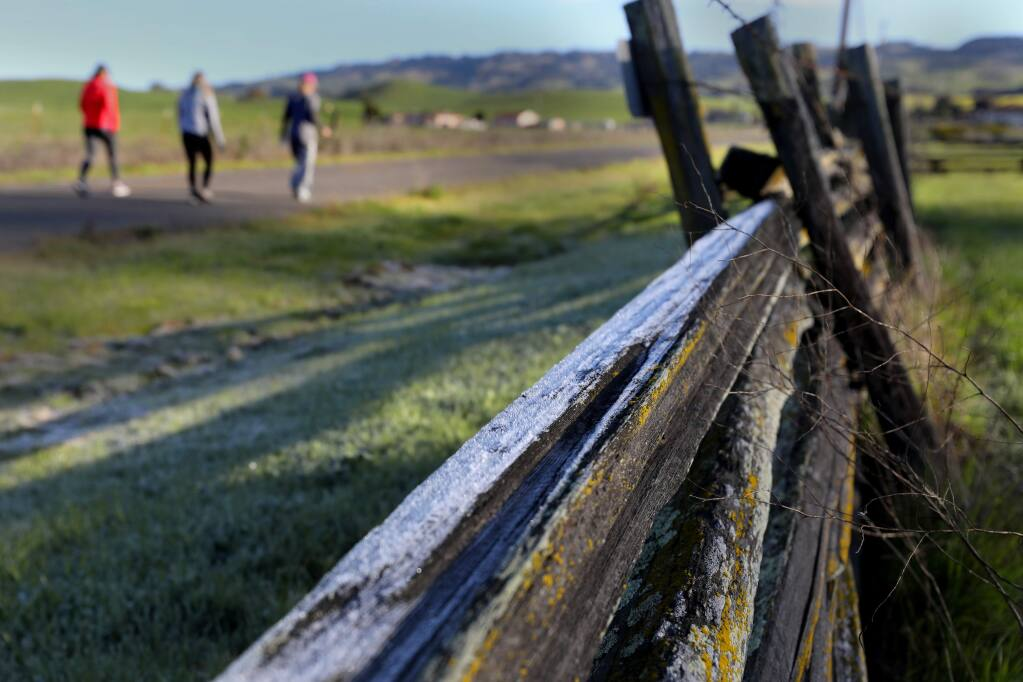 Despite chilly temperatures and frost, a group of women get some exercise along Manor Lane in Petaluma on Thursday, March 26, 2020. (BETH SCHLANKER/ The Press Democrat)