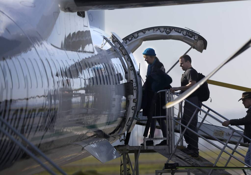 Passengers board an Alaska Airlines flight to Portland at the Sonoma County Airport on Thursday, Jan. 22, 2015. (BETH SCHLANKER / The Press Democrat)