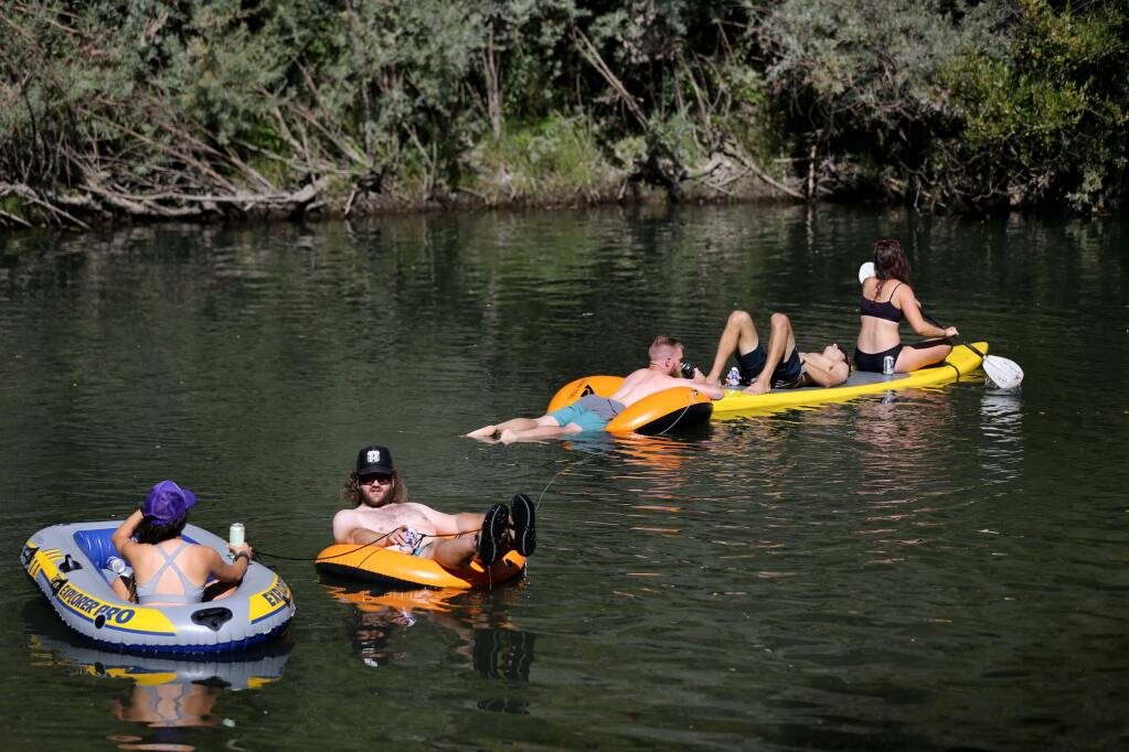 A group of friends float on the Russian River at Steelhead Beach near Forestville on Sunday, September 15, 2019. (BETH SCHLANKER/ The Press Democrat)