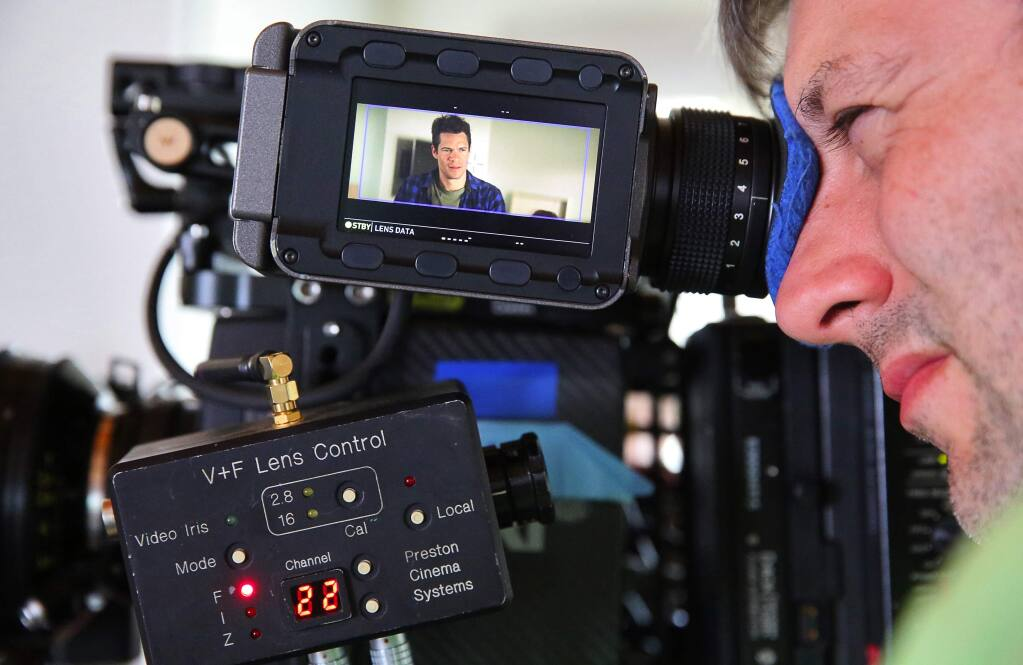 Camera operator Chris Freilic frames a shot with Hus Miller during the filming of the movie 'You Can't Say No,' at a home in Santa Rosa, on Tuesday, Aug. 9, 2016. Miller wrote and stars in the movie. (Christopher Chung/ The Press Democrat)