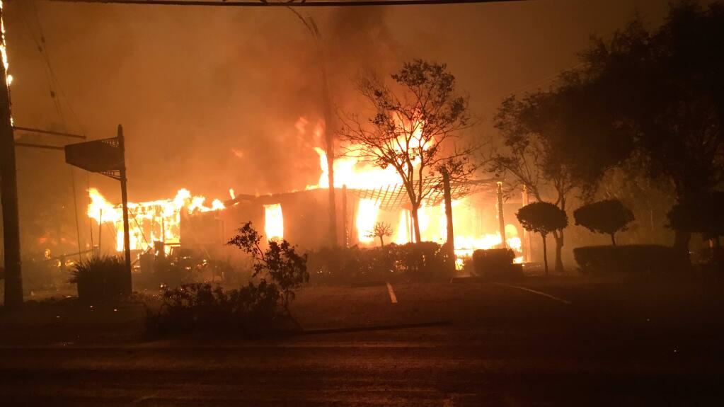 Wili's Wine Bar burns in Santa Rosa shortly after 3 a.m. on Monday, Oct. 9, 2017. (KENT PORTER/ The Press Democrat)