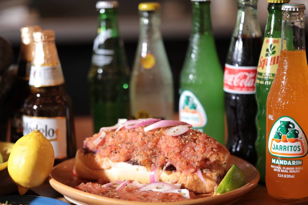 Known as a hangover cure, the torta ahogada is full of flavor. (Courtesy of Tortilla Real)