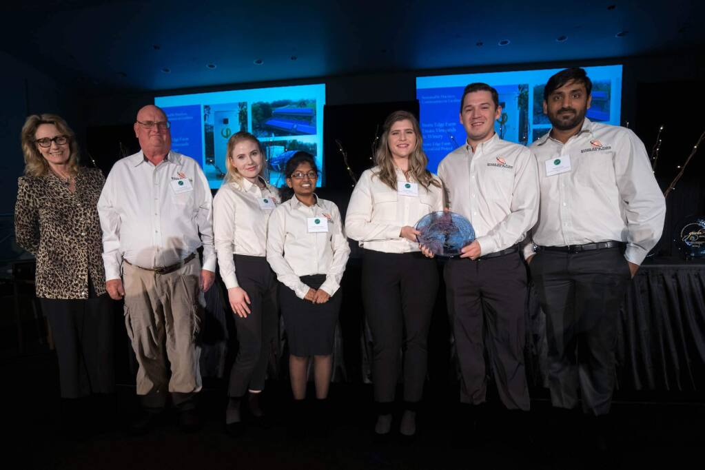 Marybel Batger, Secretary of the California Government Operations Agency, as she presented a GEELA award to the Stone Edge Farms MicroGrid team on Jan. 17, 2018. From left: Batger, Craig Wooster, SEFMG project manager, and current interns Tara Deane, Tejashwee Kandukuri, Rachel Pignata, Ryan Stoltenberg, and Trinath Vernula. (CalEPA)