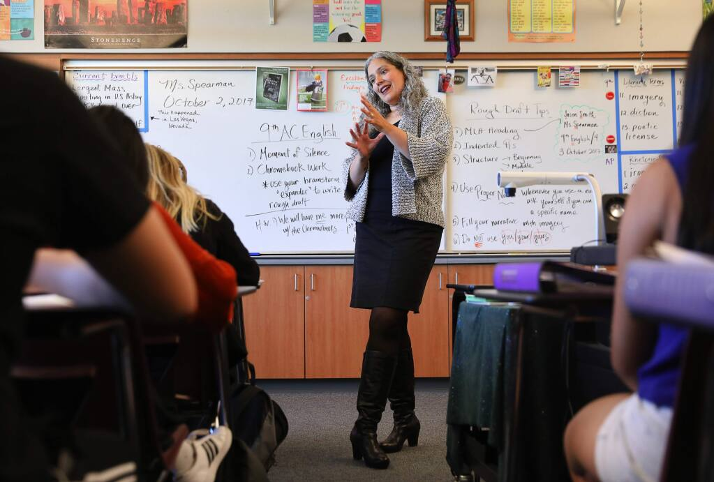 Simone Spearman discusses an essay writing assignment with her AP Language and Composition class at Piner High School, in Santa Rosa Monday, Oct. 2, 2017. Spearman has recently published her book 'The Dragons of Durga.' (Christopher Chung/ The Press Democrat)