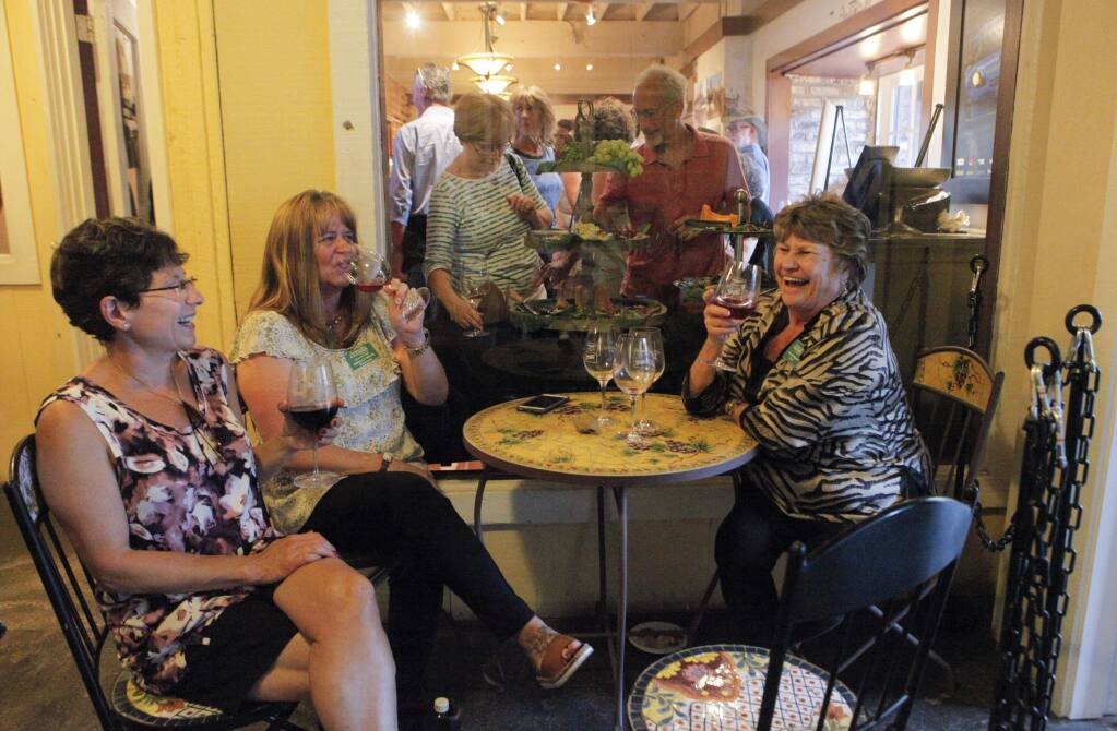 Petaluma, CA, USA.Tuesday, September 20, 2016. Celebrating the grand opening of The Adobe Road Winery tasting room at the Great Petaluma Mill in downtown are, from left to right, Joan Bunn, Shelly Silva and Onita Pellegrini. (CRISSY PASCUAL/ARGUS-COURIER STAFF)