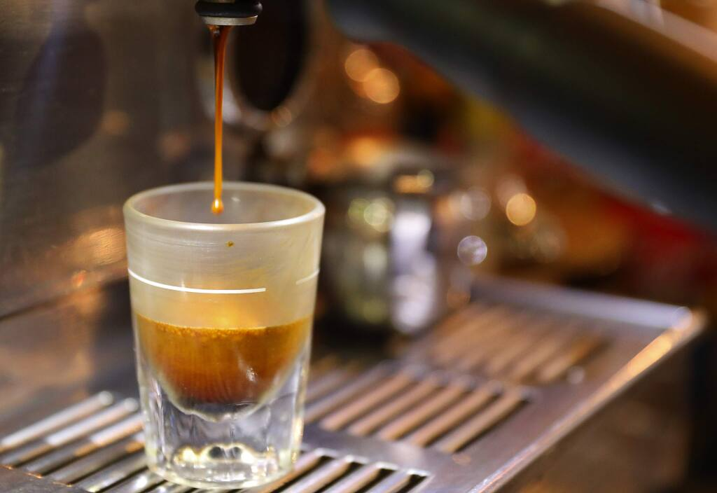 Coffee drips from an espresso machine into a glass at Crooks Coffee in Santa Rosa on Thursday, November 29, 2018. (Christopher Chung/ The Press Democrat)