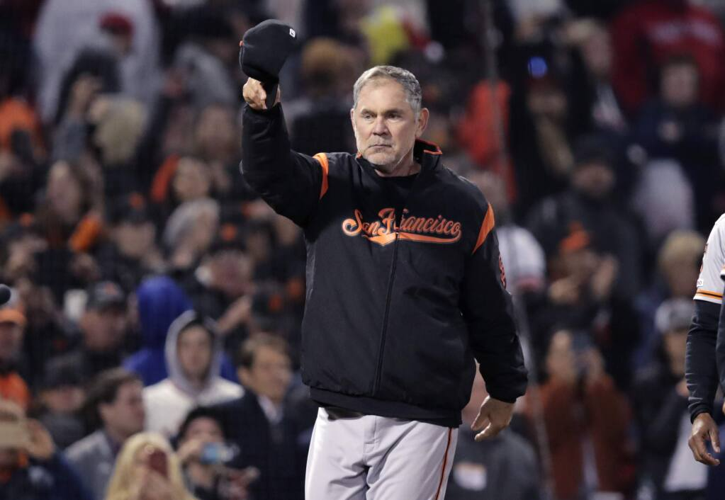 San Francisco Giants manager Bruce Bochy tips his cap after the Giants defeated the Boston Red Sox 11-3 for his 2,000th career win, at Fenway Park in Boston, Wednesday, Sept. 18, 2019. (AP Photo/Charles Krupa)