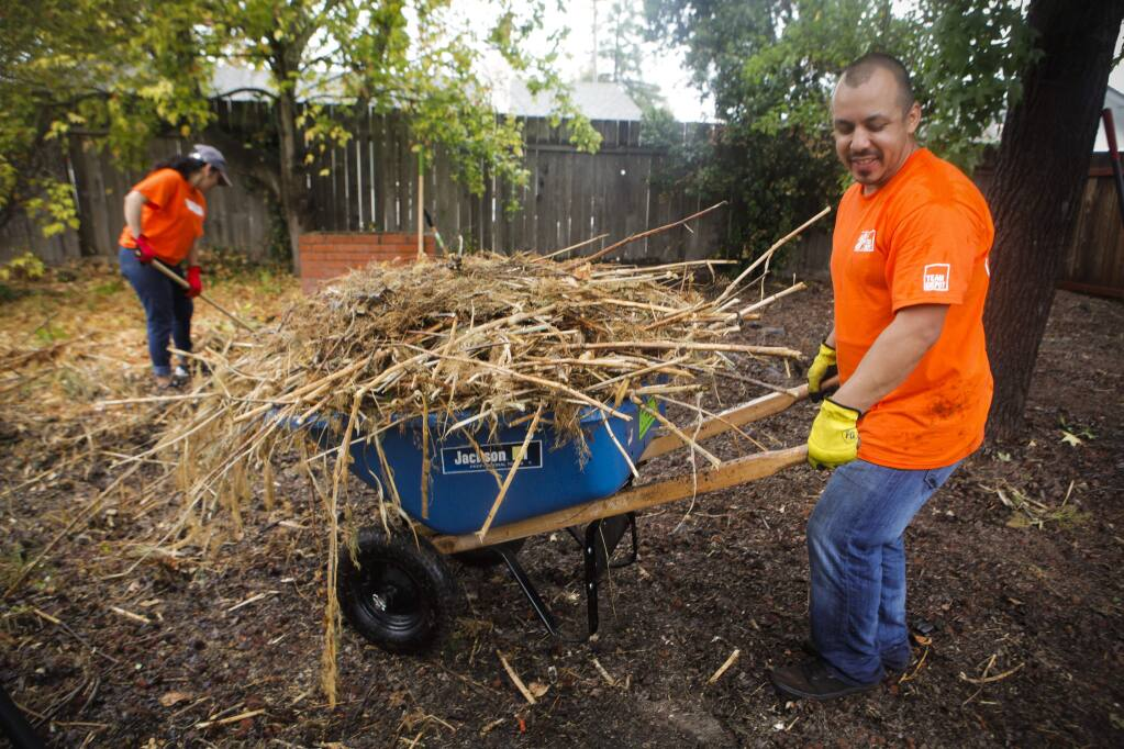 Petaluma, CA, USA. Friday, October 14, 2016._ Miguel Estrada of Fairfield was one of dozens of volunteers from North Bay area Home Depots who helped clean and repair the east Petaluma home of WWII veteran, Albert Pericou,90. (CRISSY PASCUAL/ARGUS-COURIER STAFF)