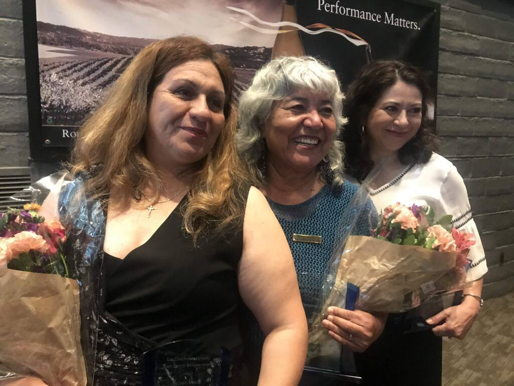 From left to right, recipients of Los Ciens first-ever Puente & Ganas Awards Nohemi Palomino Andrade, Alicia Sanchez and Gabriela Bernal pose for a photograph Friday, May 3, 2019 at the Luther Burbank Center for the Arts in Santa Rosa. (Nashelly Chavez/ Press Democrat)