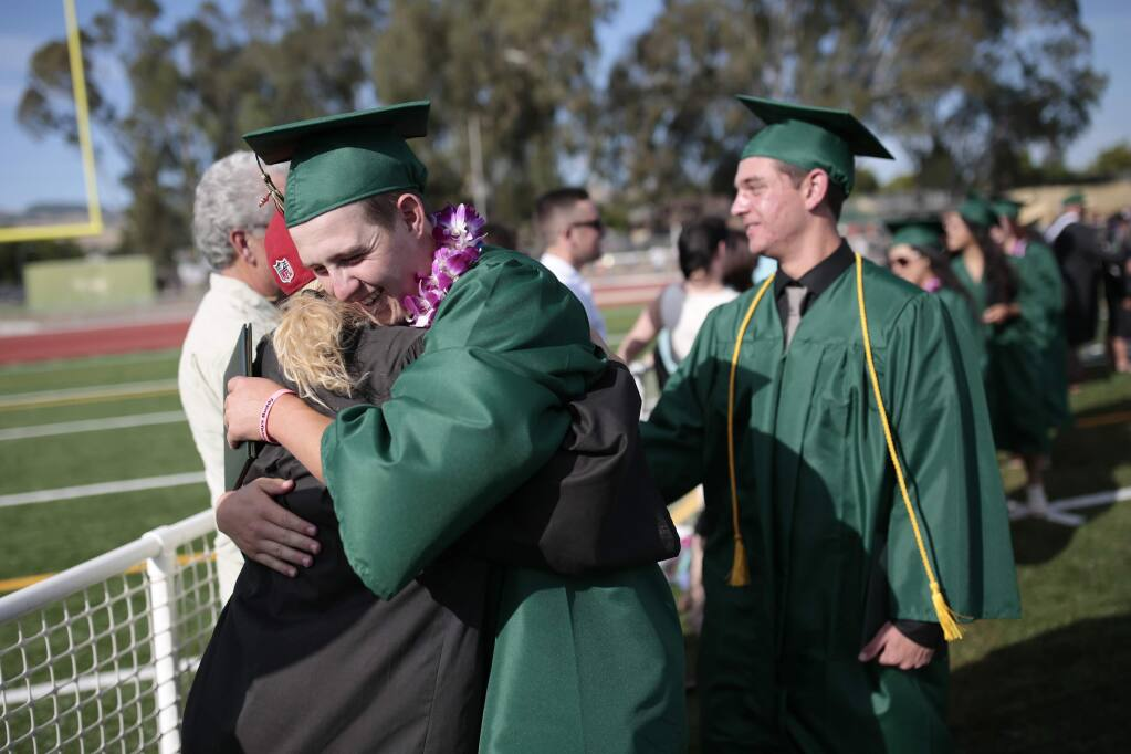 Blake Berry hugs English teacher Cassandra Bacho after receiving his diploma during the graduation ceremony at Casa Grande High School in Petaluma, on Friday, June 3, 2016. (Ramin Rahimian for The Press Democrat)