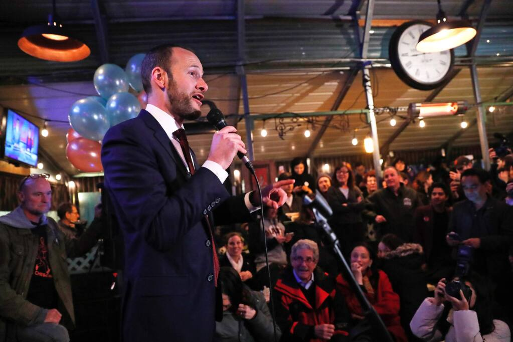 In this Tuesday, Nov. 5, 2019, photo, San Francisco District Attorney candidate Chesa Boudin speaks during an election night event at SOMA StrEat Food Park in San Francisco. Boudin, the son of anti-war radicals sent to prison for murder when he was a toddler, has won San Francisco's tightly contested race for district attorney after campaigning to reform the criminal justice system. (Scott Strazzante/San Francisco Chronicle via AP)