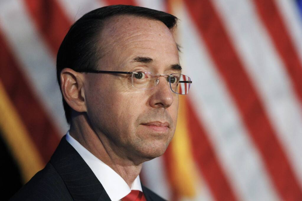 FILE - In this June 20, 2017, file photo, Deputy Attorney General Rod Rosenstein listens during the Justice Department's National Summit on Crime Reduction and Public Safety in Bethesda, Md. Former Deputy Attorney General Rosenstein told the FBI he was 'angry, ashamed, horrified and embarrassed' at the way James Comey was fired as FBI director. An FBI summary of that interview was among hundreds of pages of documents released Monday, Dec. 2, 2019, as part of a public records lawsuit brought by BuzzFeed News and CNN. (AP Photo/Jacquelyn Martin, File)