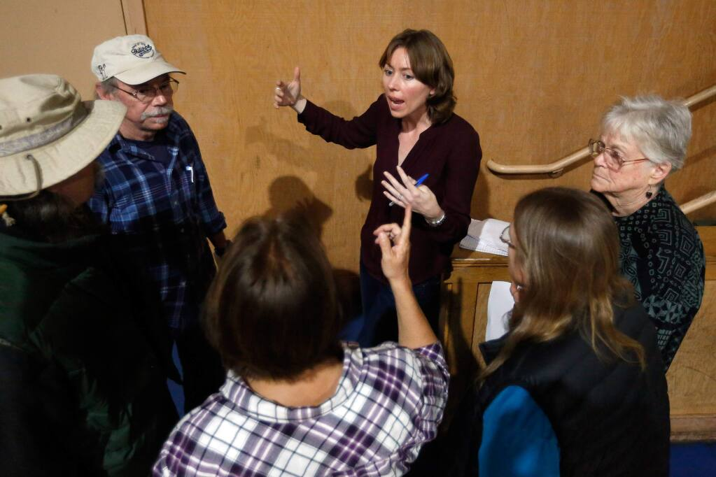 Sonoma County Fifth District supervisor Lynda Hopkins, center, talks with Guerneville residents after a town hall meeting at Guerneville School, in Guerneville, California on Wednesday, March 29, 2017. (Alvin Jornada / The Press Democrat)
