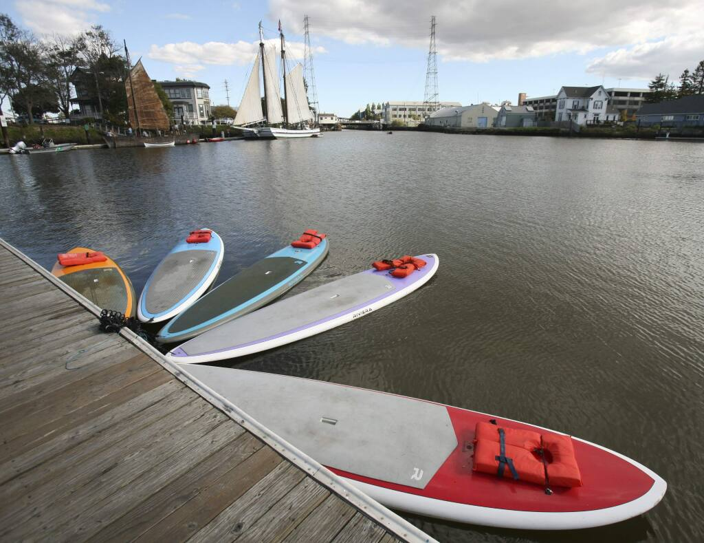 Stand Up Paddleboards parked at the dock just down from historic ships during River Heritage Days in Petaluma on Saturday, October 18, 2014. (SCOTT MANCHESTER/ARGUS-COURIER STAFF)