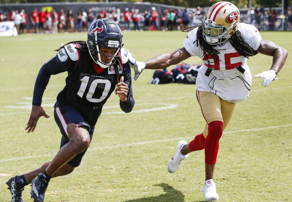 In this Aug. 16, 2018, file photo, Houston Texans wide receiver DeAndre Hopkins (10) and San Francisco 49ers defensive back Richard Sherman (25) run extra drills after a joint practice in Houston. (Brett Coomer/Houston Chronicle via AP, File)