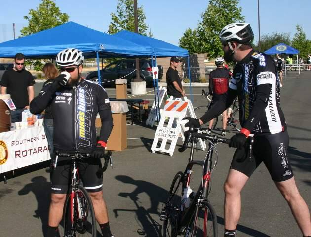 (Bob Tuttle/Argus-Courier File Photo)Southern Sonoma County Rotaract distributes coffee before riders hit the road at the Petaluma Sunrise Rotary's 3rd Annual Backroads' Challenge on Saturday May 18th, 2013. Bicyclists rode one of three challenging courses with distances from 35 to 100 miles through rural Sonoma and Marin Counties.