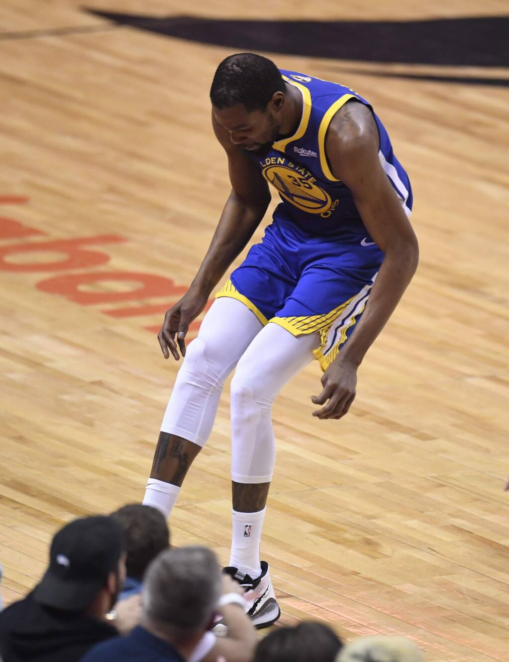 Golden State Warriors forward Kevin Durant hobbles after injuring his right leg during first-half action in Game 5 of the NBA Finals against the Toronto Raptors in Toronto, Monday, June 10, 2019. (Frank Gunn/The Canadian Press via AP)