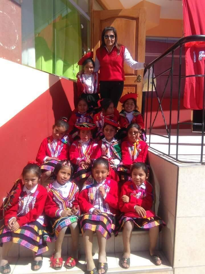 Pictured with their teacher, students at Perus Chicuchas Wasi School for Girls wear traditional outfits of Cusco during a special celebration of their indigenous roots. Rae Lewis of Sonoma opened the school in Cusco in 1997. (JEN WARD)