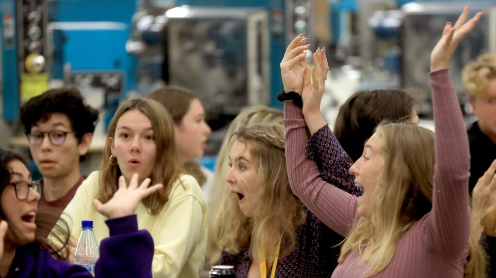 Petaluma High School's Trojan Tribune staffers from left, in yellow, Allison Perkins, Ava Rognlien and Siobhan Hernandez react as they win second place for online excellence during the Press Democrat's 2019 High School Journalism Awards in Rohnert Park, Monday, April 29, 2019. (Kent Porter / The Press Democrat) 2019
