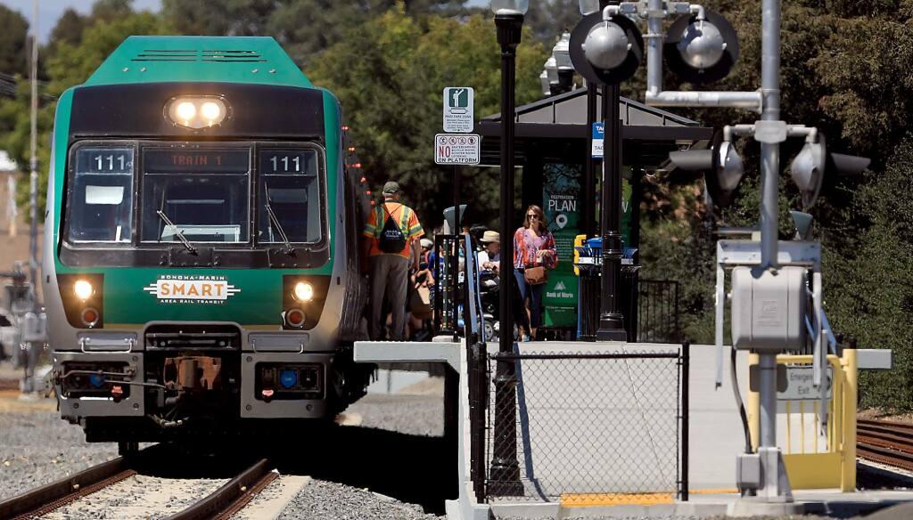 A SMART train makes a stop at the Historic Railroad Square depot, Friday, August 17, 2018 in Santa Rosa. (Kent Porter / The Press Democrat) 2018