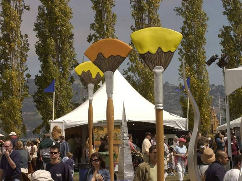The crowd mingls among giant paint brushes at the Sausalito Arts Festival. ho