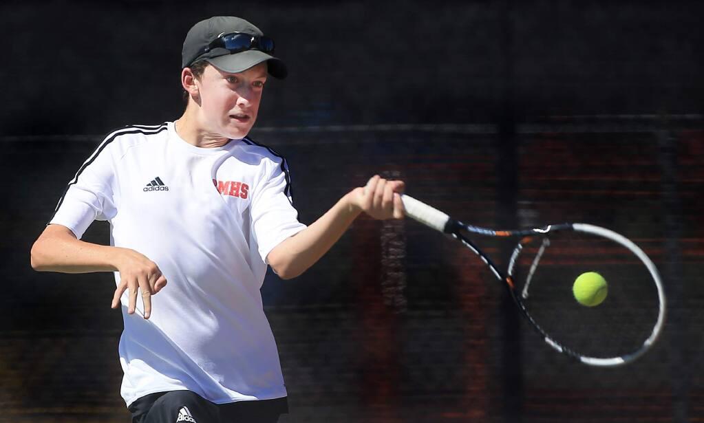 Montgomery High School freshman Justin Richter returns a shot during the NBL tennis finals at Santa Rosa High School, Monday April 25, 2016. (Kent Porter / Press Democrat ) 2016