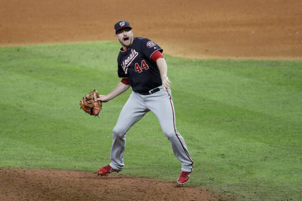 Washington Nationals relief pitcher Daniel Hudson celebrates after Game 7 of the baseball World Series against the Houston Astros Wednesday, Oct. 30, 2019, in Houston. The Nationals won 6-2 to win the series. (AP Photo/Sue Ogrocki)